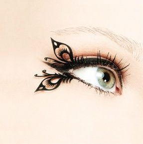Katniss Everdeens butterfly eyelashes from the final ceremony of Hunger Games they were SO PRETTY