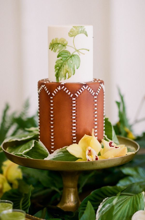 tropical inspired cake - photo by Krista Mason Photography http://ruffledblog.com/tropical-leaves-and-sea-glass-wedding-shoot: