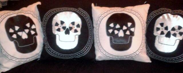 Black, white and grey skull cushions. https://folksy.com/items/6590019-Skull-Applique-Cushion