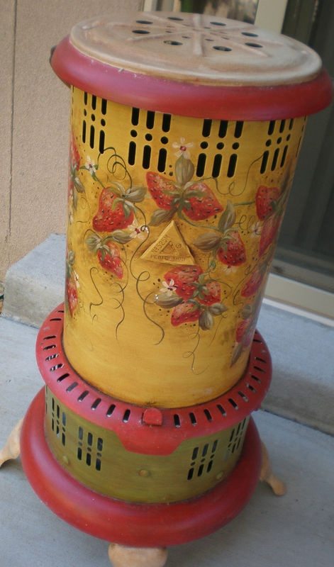 antique oil heater- cute paint upgrade-  i have seen these with a candle inside-  light flickering through- want one!