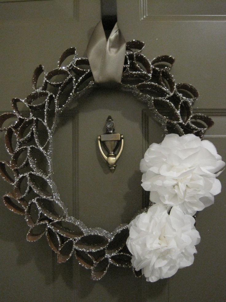 winter wreath...made from flattened and cut toilet paper tubes, glued together then painted and/or flocked.