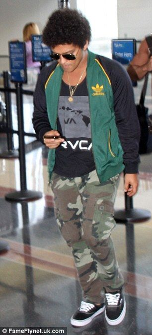 Bruno Mars puts on a brave face at airport following his mother's tragic death as he prepares for world tour | Daily Mail Online
