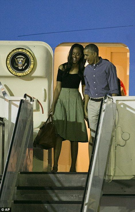 The president looked thrilled to be reunited with eldest daughter Malia as they descended the steps of Air Force One