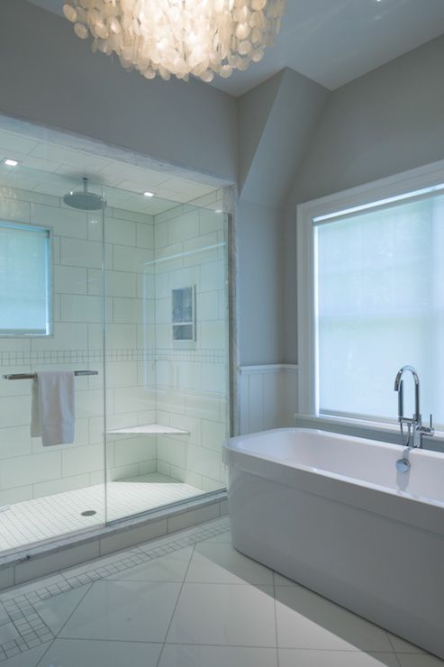 White And Gray Bathroom Features Vaulted Ceiling Over