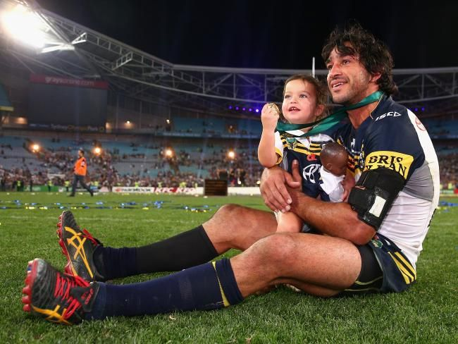 Cowboys captain Johnathan Thurston takes a moment in the centre of the field with his daughter Frankie Thurston after winning the 2015 NRL Grand Final against the Brisbane Broncos. (Photo by Cameron Spencer/Getty Images)