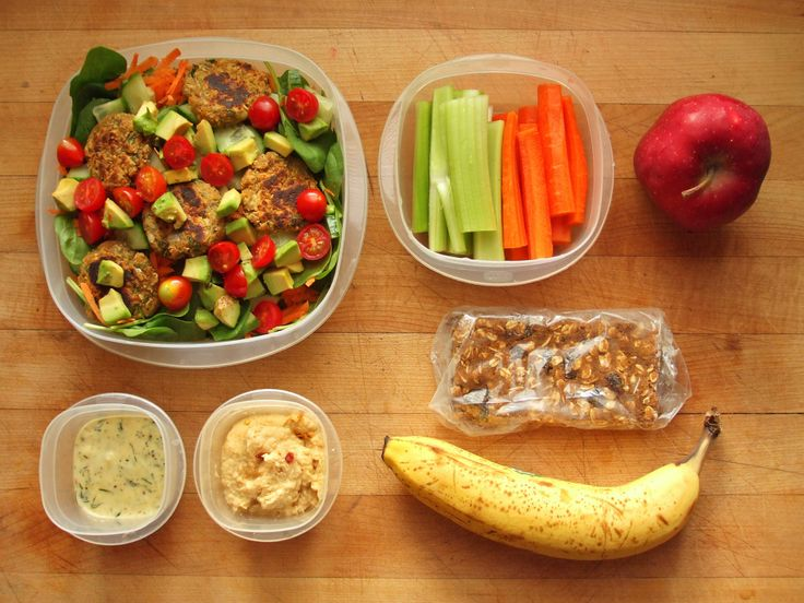 spinach salad with cucumber, carrot, avocado, grape tomatoes, falafel, and ranch dressing, celery and carrots with hummus, red delicious apple, oatmeal protein bar, and a banana