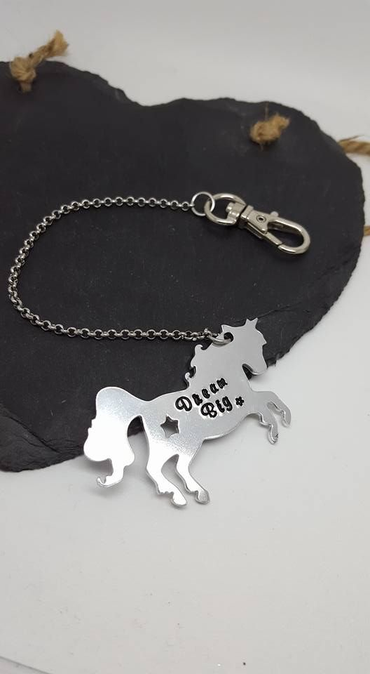 A beautiful hand stamped journal charm, made from Aluminium (chain is stainless steel). Each letter is hand stamped and I can personalise with a name or short phrase. I have a number of different fonts available. The one in the picture is Murray Hill.