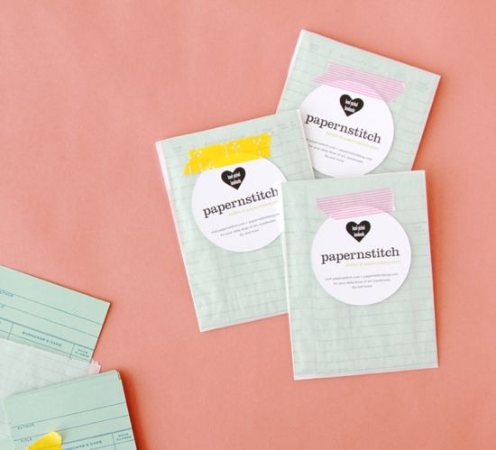 die-cut circle business cards in little envelopes