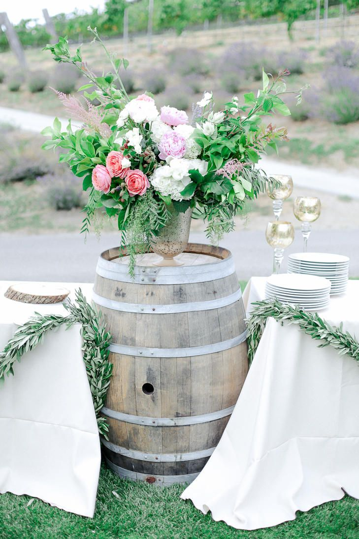 Wild Romantic Flower Arrangements on Barrel Pedestal |  JULIE CAHILL PHOTOGRAPHY | COASTSIDE COUTURE | SEASCAPE FLOWERS | http://knot.ly/6493BQyKR