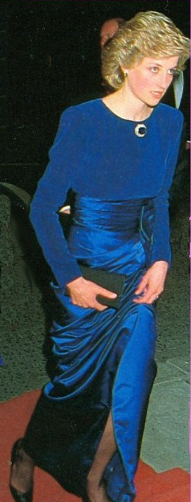 Princess Diana  Royal-blue evening dress with velvet bodice and duchesse satin cumberband and skirt.  Designer: Catherine Walker, Price raised at auction: $ 28,750