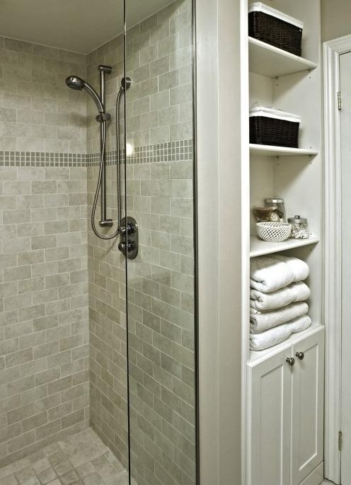 like the tile in the shower and the tower storage