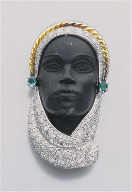 Carved Ebony, Diamond and Emerald Blackamoor Clip-Brooch -  Platinum, 79 diamonds ap. 1.90 cts., ap. 14 dwt.