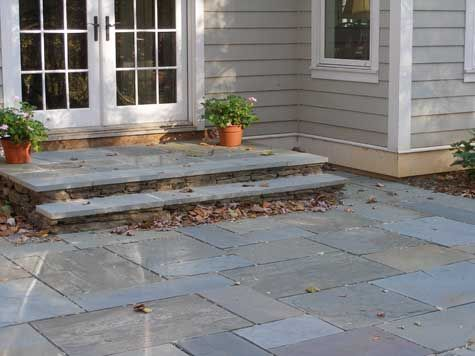 Landing Is Bluestone With Natural Stone Risers. It Evens A Seat Wall