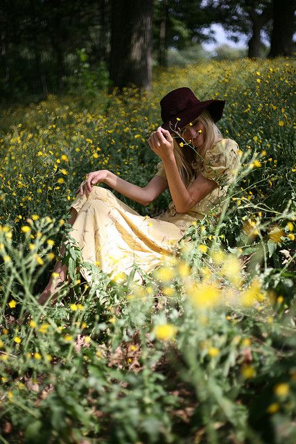 I love this picture, but I know if I were sitting in a field of flowers I would be sneezing from the pollen and freaking aout that bugs were crawling on me LOL
