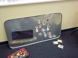 An oil drip pan--brilliant idea for a magnet board!  Can use with magnetic puzzle.