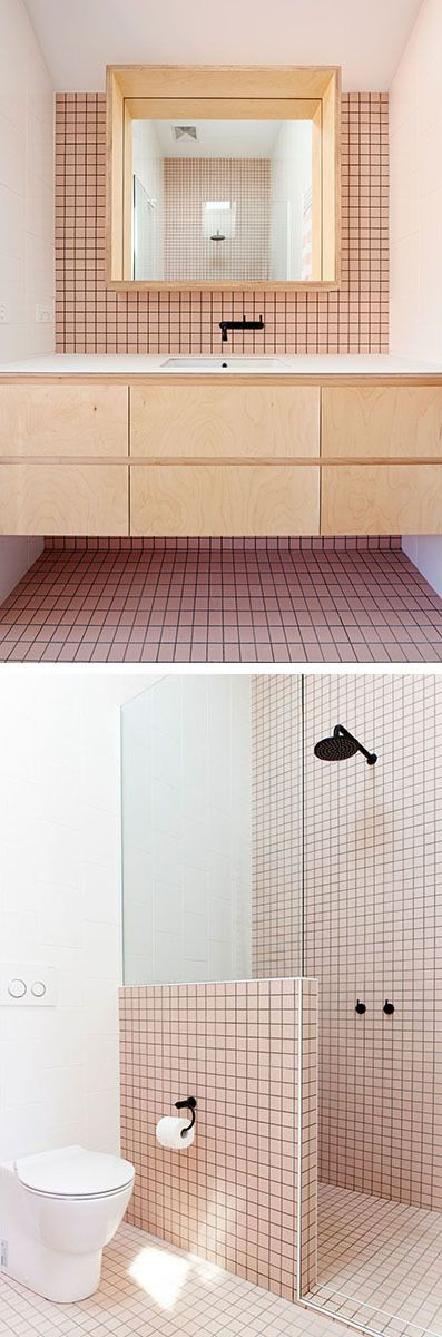 Soft pink tiles soften the appearance of this bathroom.: