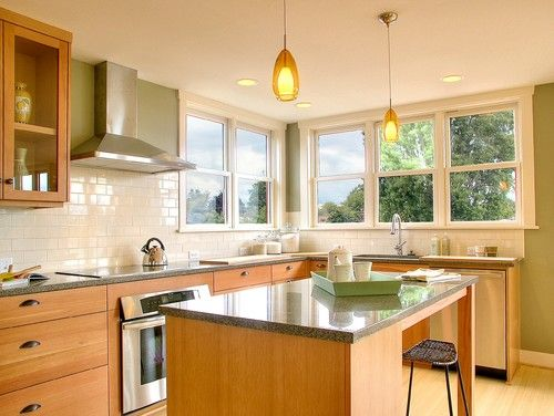 white subway tile and natural maple cabinets