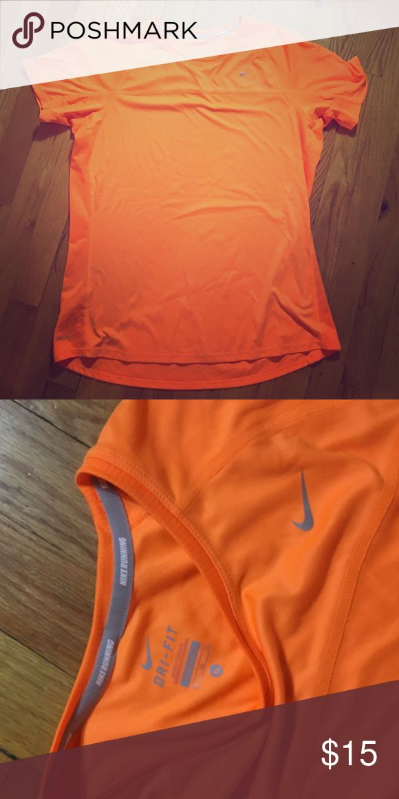 Nike women's running top. Authentic Nike women's running top, short sleeves. Color is orange, great for running outside or at night. Size is XL. Dri-Fit material keeps you cool while running. Used but in great condition. Nike Tops Tees - Short Sleeve