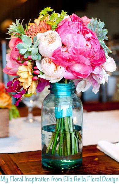 Perfect Wedding Flowers  Like the Mason Jars but transform them into glamorous vases with a glue gun, pearls and other goodies!  I Love This Idea!