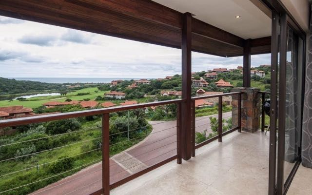 Zimbali Views 1 in Zimbali Coastal Resort (Sleeps 8). Brand new and beautifully appointed, this modern, luxurious villa enjoys impressive, panoramic views across the Zimbali golf course, the conservation area and towards the ocean in the distance. The entrance level is on the top level and reveals amazing living and entertainment area. #Where2Stay #Zimbali