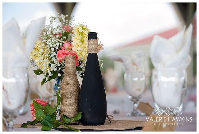 Repurposed wine bottle centerpieces.   ...Valerie Hawkins Photography