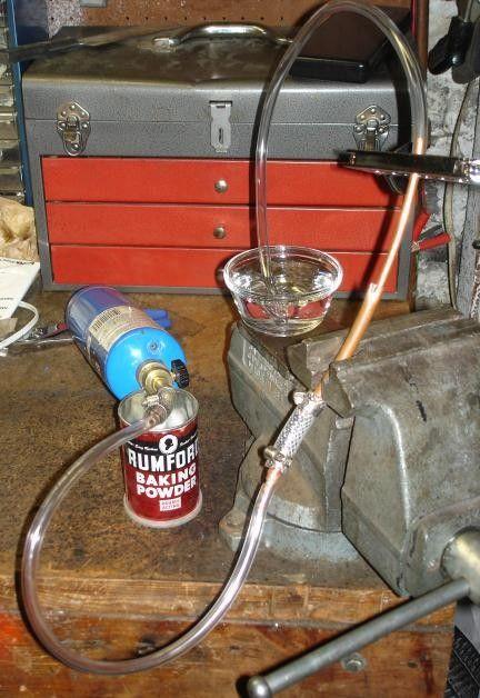 Propane Brazing Setup by AC_Hacker -- Homemade propane brazing setup constructed from a propane torch, plastic tubing, propane bottle, and a bowl of water. http://www.homemadetools.net/homemade-propane-brazing-setup