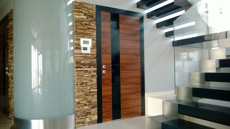 Model: Horizontalis Detail: natural veneer Palisander Santos + Insert black glass (lacobel); frame: natural veneer oak + black colour