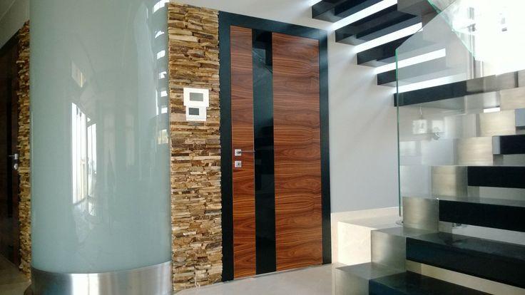 Model: Horizontalis Detail: natural veneer Palisander Santos + Insert black glass (lacobel); frame: natural veneer oak + black colour