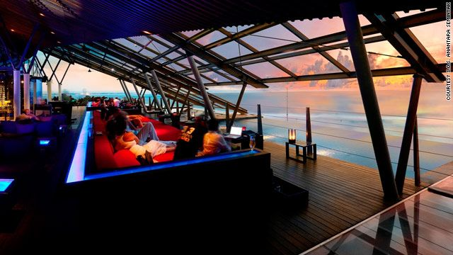 Watch dramatic sunsets over the Indian Ocean at the S.O.S. Anantara Seminyak in Bali, Indonesia.