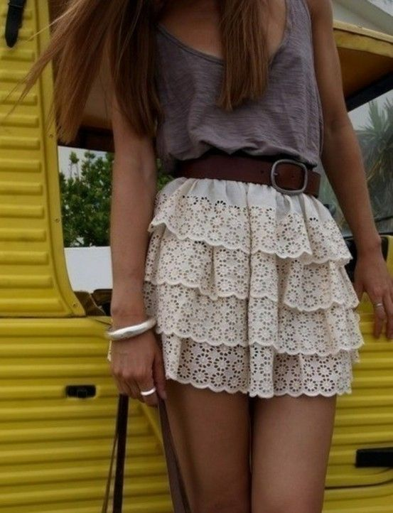 CUTE* cut up dark gray sleeveless t-shirt, design overlapped off-white/clear through waved skirt, medium dark brown belt with gold strap, and accessories