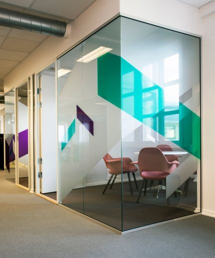 glass office wall. solid large shapes of colored glass office wall