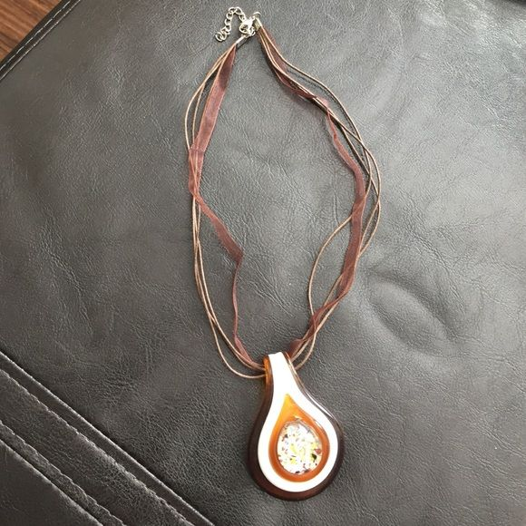 Blown glass necklace A brown and white blown glass with a mix color center on a leather and lace chord necklace. Jewelry Necklaces