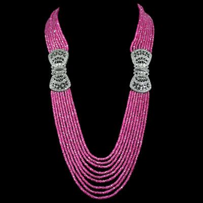 Pink Sapphire Beads & Diamond Bow Necklace. Accompanied by 305.10 carats of Pink Sapphire and 5.10 carats of Diamonds. Bows are set in 18 karat White Gold.
