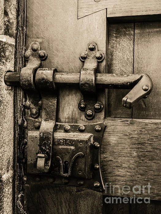 Doors of the World Series by Lexa Harpell. Close up detail of door lock in Bruges in Sepia.