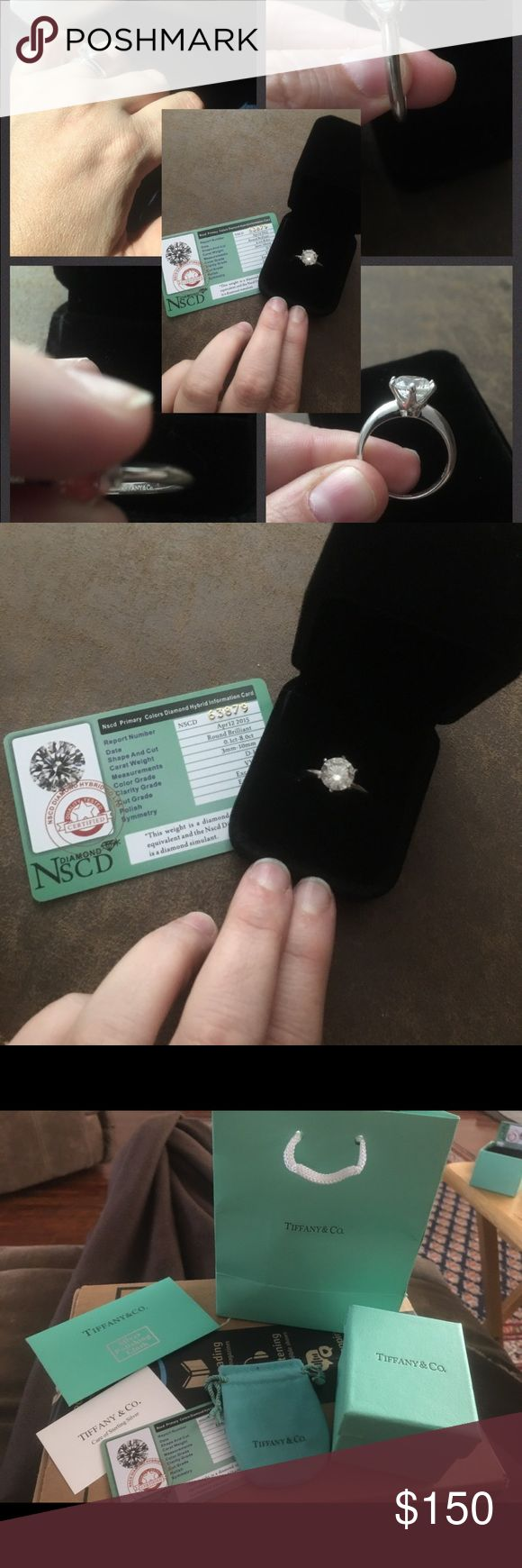 """925 Sterling Silver """"Tiffany & Co"""" Solitaire Ring 3.0 carat diamond hybrid, size 9, stamped Sterling Silver, stamped Tiffany & Company. Looks very much like the real deal. Comes with all gift box and storage items pictures with Tiffany logo on all. Also comes with Sterling a silver Polishing cloth :) Tiffany & Co. Jewelry Rings"""