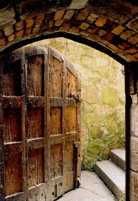 Old beautiful wooden door - note the roller on the bottom to open it. Most necessary, I would think!