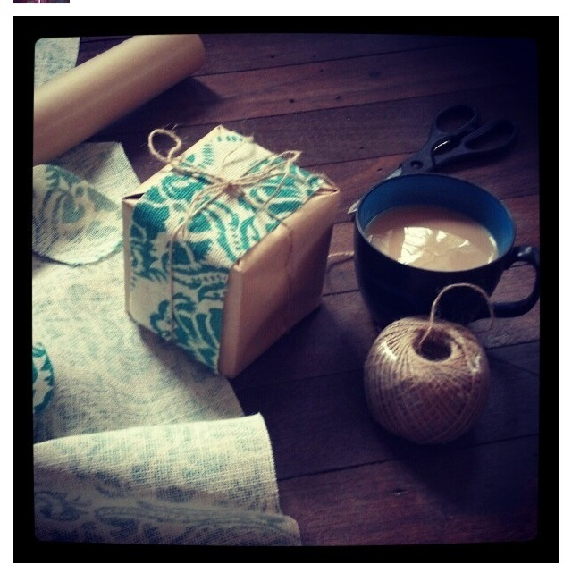 Wrapping using printed hessian, brown paper and twine