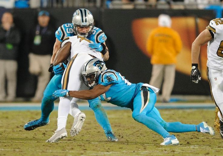 Saints Panthers Football Luke Kuechly, Tim Hightower