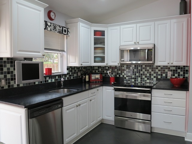 Kitchen Has Stainless Steel Dishwasher Oven Stove