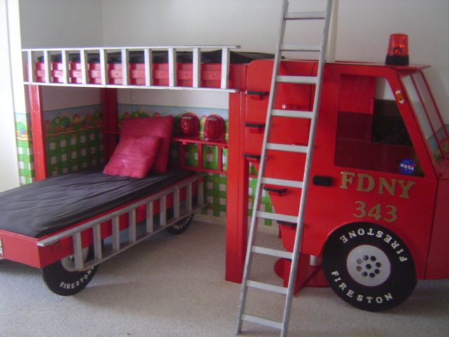 Firetruck bed, can probably fit a full mattress underneath!
