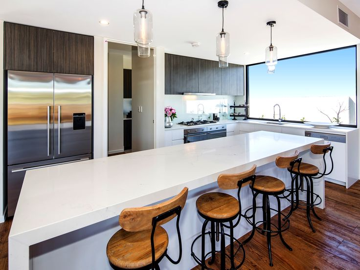 Villa on the Green - Kitchen 2306 Vardon Lane, Sanctuary Cove, Queensland. Luxury holiday home for exclusive escapes. #holidays #luxuryhomes #holidayhomes #queenslandholiday #luxuryescapes #getaway
