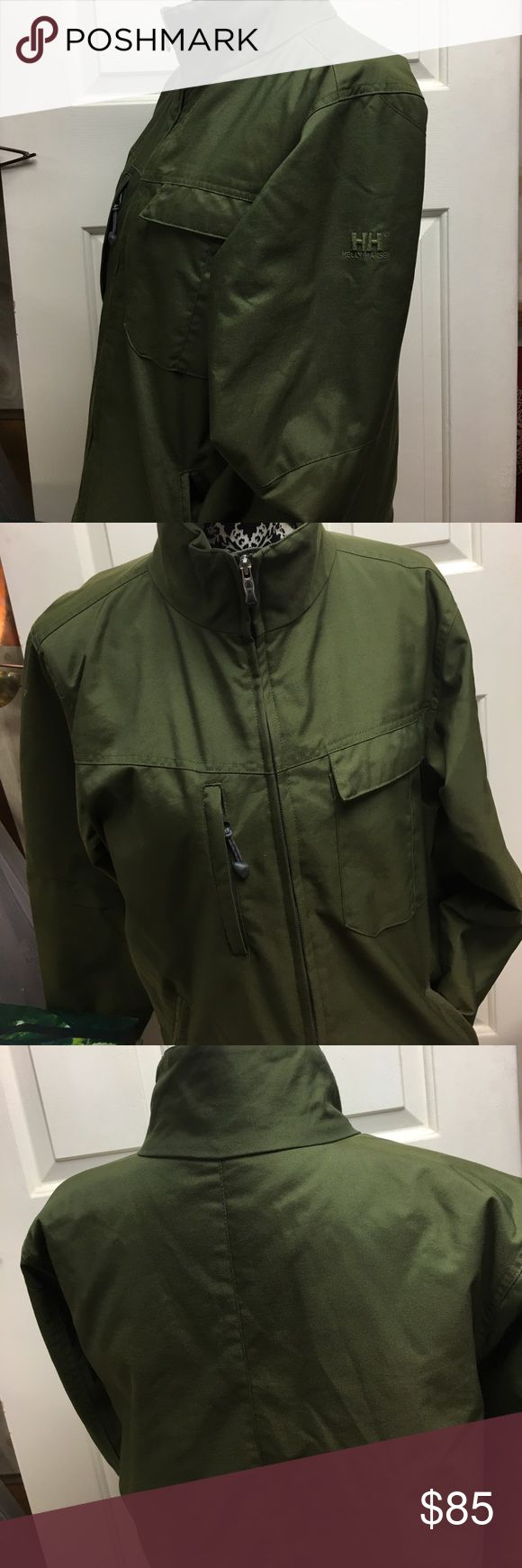 HELLY HANSEN MEDIUM OLIVE  JACKET Brand new from a sample sale . Measures 20 inches underarm to underarm and 26 inches in length Helly Hansen Jackets & Coats Utility Jackets