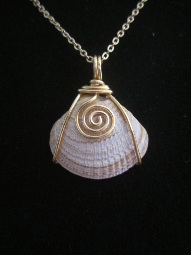 Wire wrapped shell pendant.