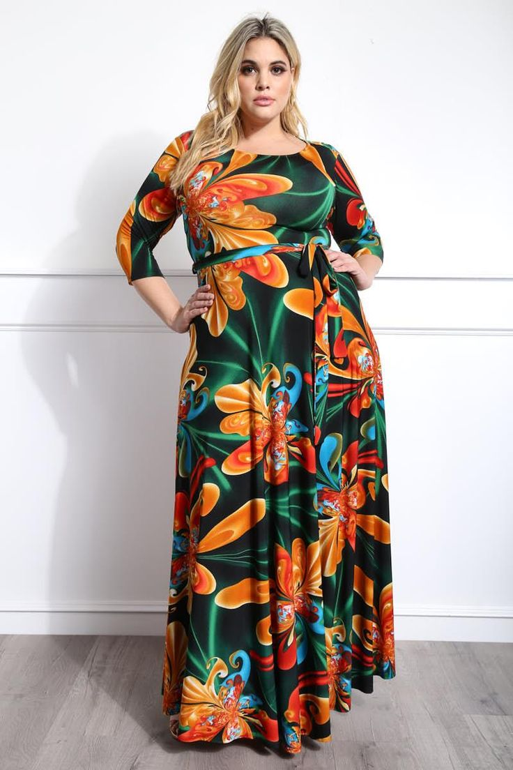 Set your dreams in motion with this stunning plus size maxi dress. Features a vibrant floral print fabric that feels like a permanent vacation on your skin. Made with a scoop neckline, 3/4 sleeves, and matching sash to define your waist. A flowy silhouette adds stunning movement with every step you take.