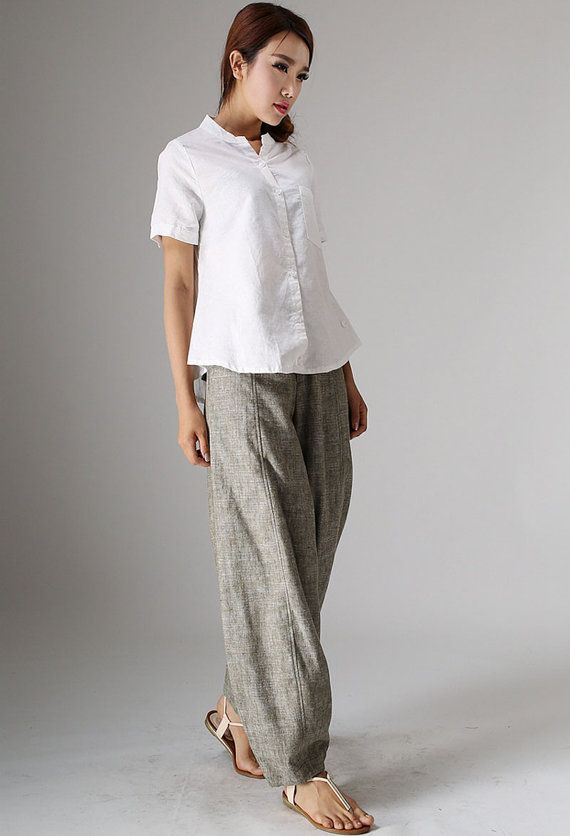 Stay comfortable and look terrific all season long with these beige linen pants. Linen is an ideal choice for clothing and can be best described as an