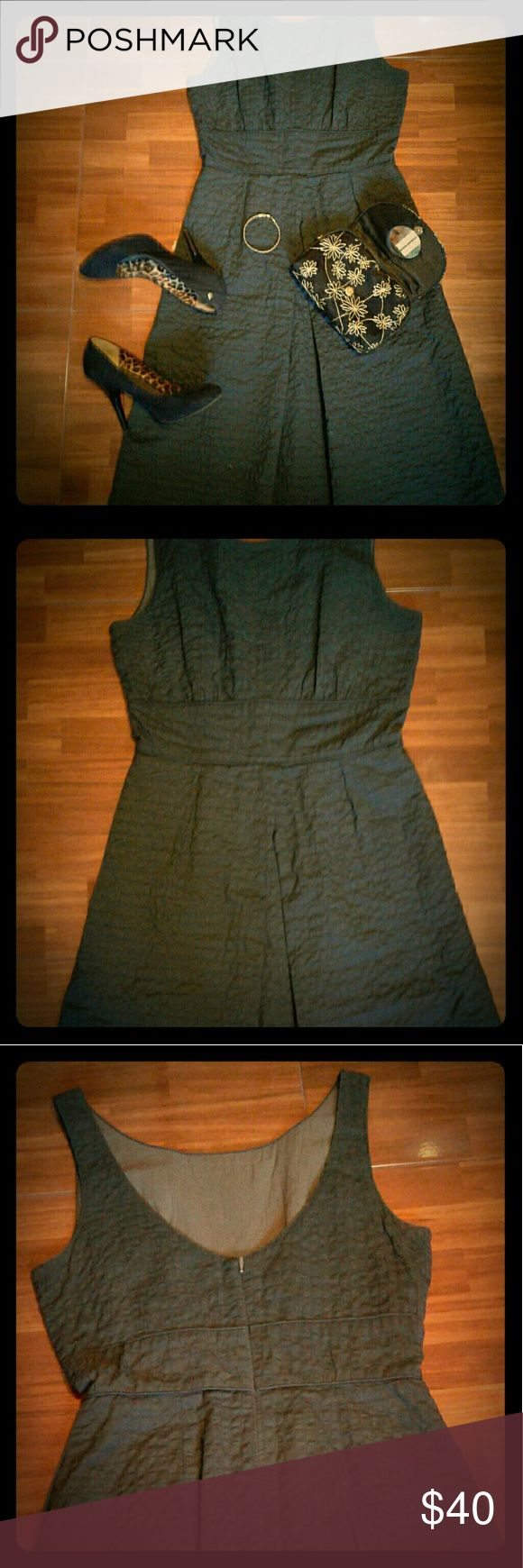 "J. Crew Charcoal Gray Sleeveless A-Line Dress Gently worn J.Crew dress. Sleeveless dress with a bateau neckline, low scoop back, and cinched waist. Zipper located on the back with a closure. Below knee length. Fabulous dinner dress!  100% Cotton with cotton lining.  Length: 37""  Bust: 32""  Waist: 28"" J. Crew Factory Dresses Midi"