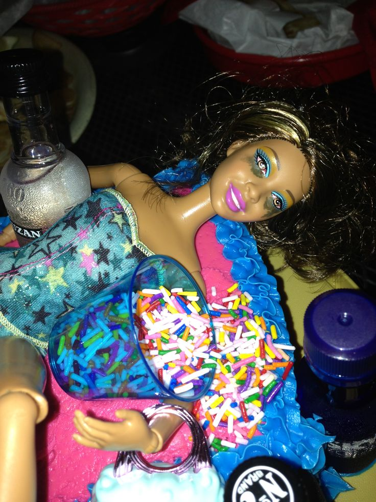 Close up of Homemade Drunk Barbie 24th birthday cake. Trash can full of throw up sprinkles, Makeup messed up and all