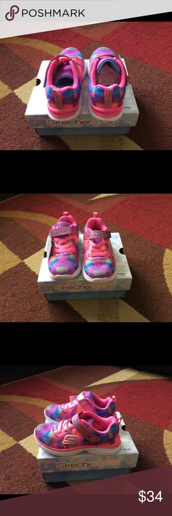 Girl/Toddler sketchers sneakers size 8 New in Box NWT & in box Girl/Toddler sketchers sneakers size 8 in multi color Velcro  From smoke & pet free home No holes & no stain Bundle for less & have a great day! sketchers Shoes Sneakers