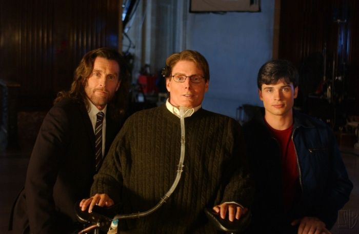 """Christopher Reeve (center) played Dr Virgil Swann in the """"Smallville"""" series (2001).  He initally played Superman in """"Superman"""" (1978) and its three sequels.  Seen here with cast members John Glover (Lionel Luthor) and Tom Welling (Clark Kent)."""