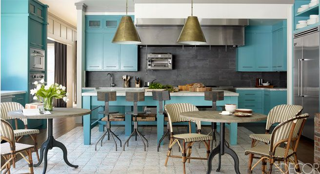 Custom-made cabinets and island are painted in Benjamin Moore's Majestic Blue.